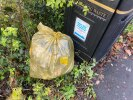 Next to bin by bus stop. Keynsham Wombles bag of picked litter ready for collection. Thanks you.
